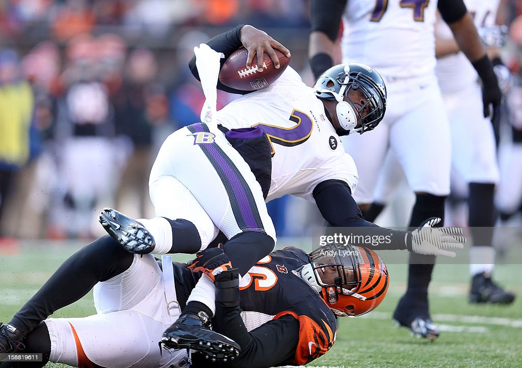 Tyrod Taylor #2 of the Baltimore Ravens is sacked by Carlos Dunlap #96 of the Cincinnati Bengals during the NFL game at Paul Brown Stadium on December 30, 2012 in Cincinnati, Ohio.
