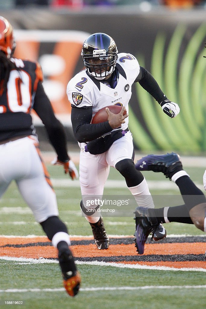 Tyrod Taylor #2 of the Baltimore Ravens runs the football upfield during the game against the Cincinnati Bengals at Paul Brown Stadium on December 30, 2012 in Cincinnati, Ohio. The Bengals defeated the Ravens 23-17.