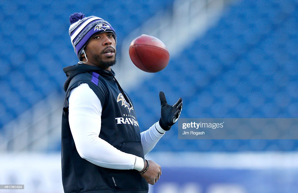 Tyrod Taylor of the Baltimore Ravens warms up before the 2014 AFC Divisional Playoffs game against the New England Patriots at Gillette Stadium on...
