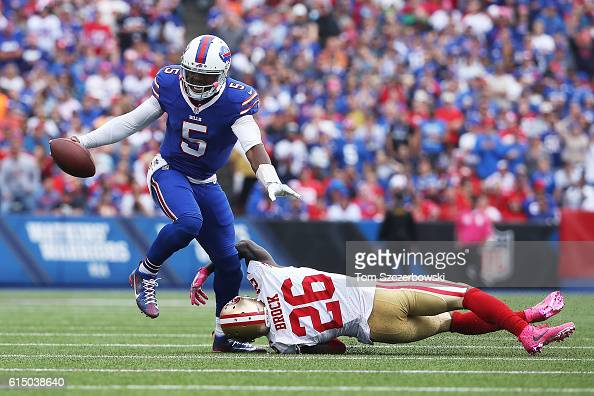 Tyrod Taylor of the Buffalo Bills breaks the tackle by Tramaine Brock of the San Francisco 49ers during the first half at New Era Field on October 16...