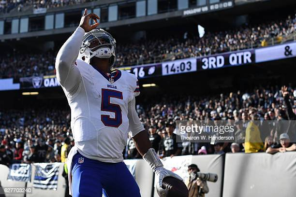 Tyrod Taylor of the Buffalo Bills celebrates after 12yard touchdown against the Oakland Raiders during their NFL game at Oakland Alameda Coliseum on...