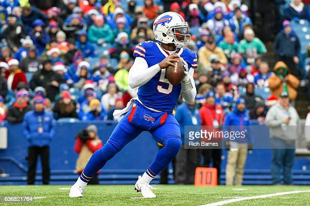 Tyrod Taylor of the Buffalo Bills drops back to pass against the Miami Dolphins during the first quarter at New Era Field on December 24 2016 in...