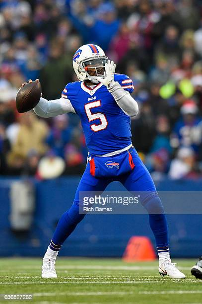 Tyrod Taylor of the Buffalo Bills drops back to pass against the Miami Dolphins during the fourth quarter at New Era Field on December 24 2016 in...