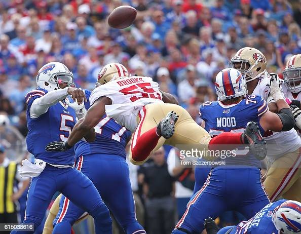 Tyrod Taylor of the Buffalo Bills gets a pass off as Ahmad Brooks of the San Francisco 49ers comes flying in during the first half at New Era Field...