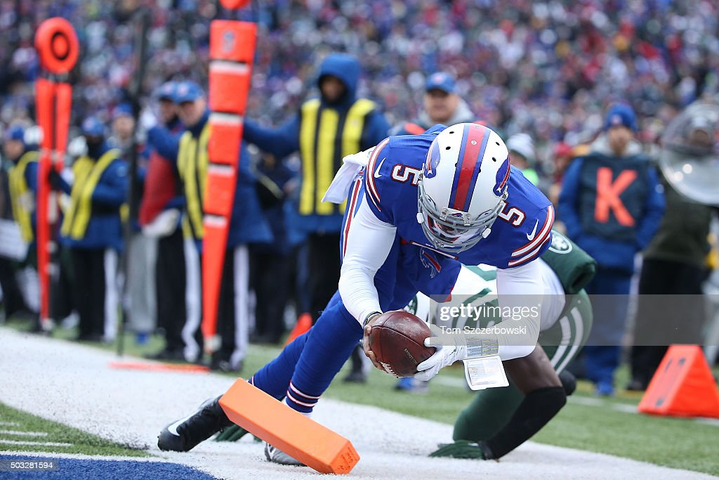 Tyrod Taylor of the Buffalo Bills gets the ball inside the touchdown marker before he is hit out of bounds for the score against the New York Jets...