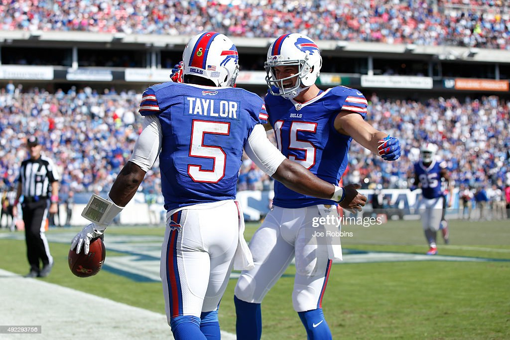 Tyrod Taylor of the Buffalo Bills is congratulated by Chris Hogan after a 22yard touchdown run against the Tennessee Titans in the third quarter at...