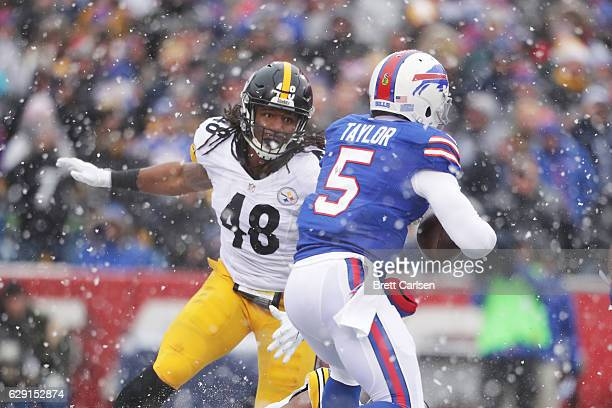 Tyrod Taylor of the Buffalo Bills is sacked by Bud Dupree of the Pittsburgh Steelers during the first half at New Era Field on December 11 2016 in...