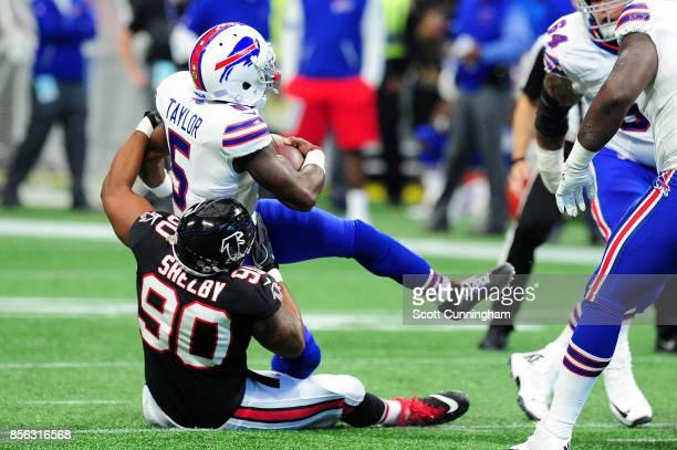Tyrod Taylor of the Buffalo Bills is tacked by Derrick Shelby of the Atlanta Falcons during the first half at MercedesBenz Stadium on October 1 2017...
