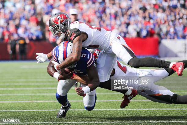 Tyrod Taylor of the Buffalo Bills is tackled by Justin Evans of the Tampa Bay Buccaneers and Chris Conte of the Tampa Bay Buccaneers on October 22...