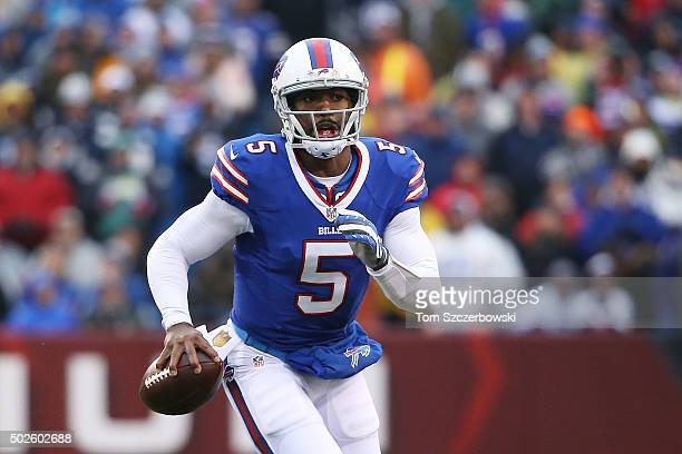 Tyrod Taylor of the Buffalo Bills looks to throw against the Dallas Cowboys during the first half at Ralph Wilson Stadium on December 27 2015 in...