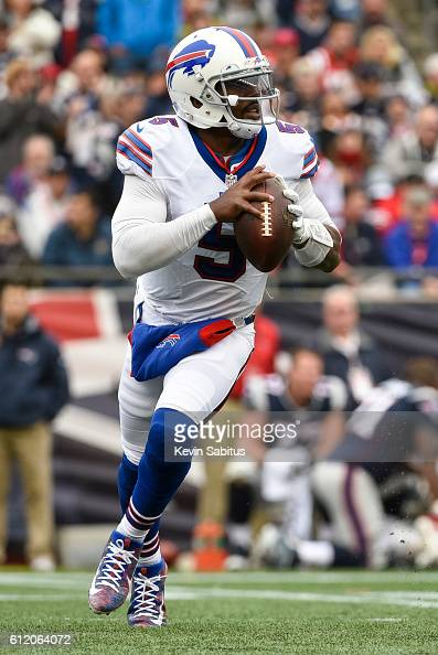 Tyrod Taylor of the Buffalo Bills looks to throw down field as he rolls out of the pocket in the third quarter against the New England Patriots at...