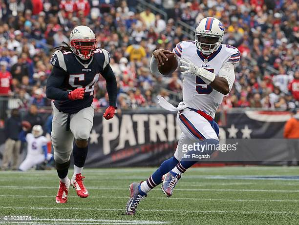 Tyrod Taylor of the Buffalo Bills runs as Dont'a Hightower of the New England Patriots chases him in the first half at Gillette Stadium on October 2...