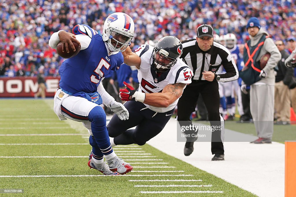 Tyrod Taylor #5 of the Buffalo Bills runs for a touchdown after slipping a tackle by John Simon #51 of the Houston Texans during the first half at Ralph Wilson Stadium on December 6, 2015 in Orchard Park, New York.