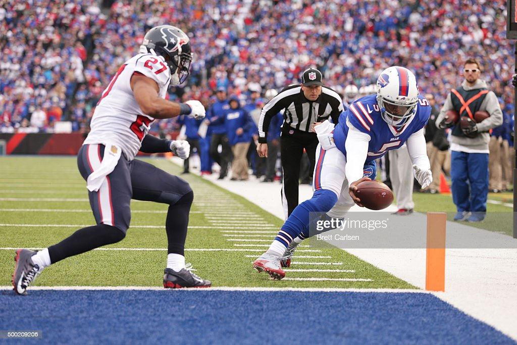 Tyrod Taylor #5 of the Buffalo Bills runs for a touchdown as Quintin Demps #27 of the Houston Texans defends during the first half at Ralph Wilson Stadium on December 6, 2015 in Orchard Park, New York.