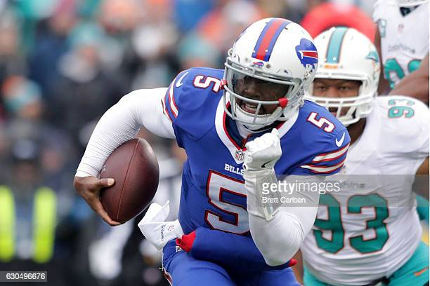 Tyrod Taylor of the Buffalo Bills runs the ball against the Miami Dolphins during the first half at New Era Stadium on December 24 2016 in Orchard...