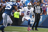 Tyrod Taylor of the Buffalo Bills runs the ball as Jalil Brown of the Indianapolis Colts defends during the first half at Ralph Wilson Stadium on...