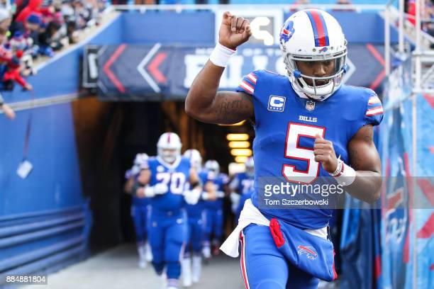 Tyrod Taylor of the Buffalo Bills runs to the field to warm up for a game against the New England Patriots on December 3 2017 at New Era Field in...