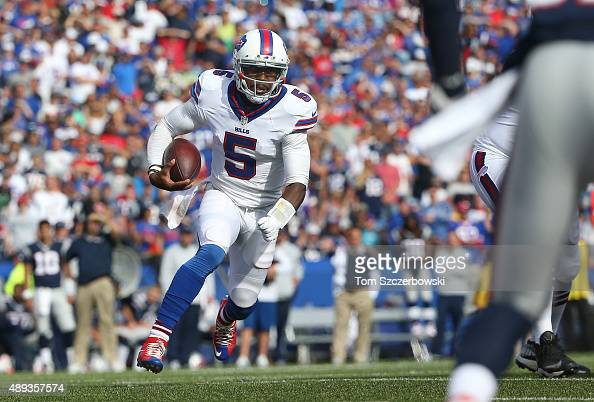 Tyrod Taylor of the Buffalo Bills rushes for a touchdown during NFL game action against the New England Patriots at Ralph Wilson Stadium on September...