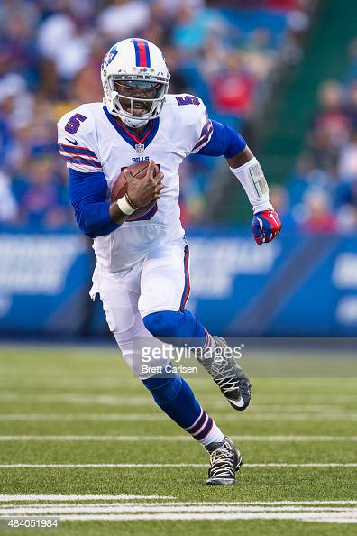 Tyrod Taylor of the Buffalo Bills scrambles during the first half against the Carolina Panthers on August 14 2015 during a preseason game at Ralph...