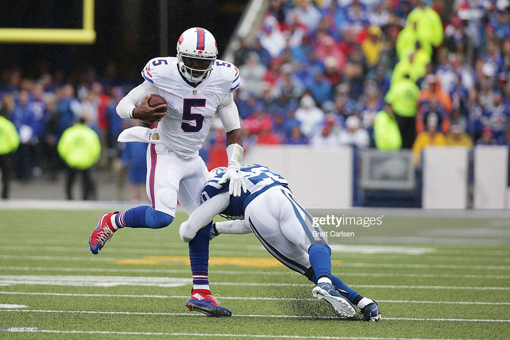 Tyrod Taylor of the Buffalo Bills scrambles outside the pocket as Darius Butler of the Indianapolis Colts defends during the first half at Ralph...