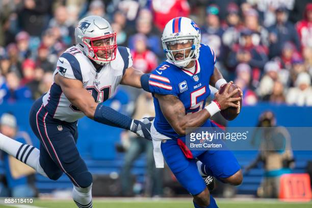 Tyrod Taylor of the Buffalo Bills scrambles with the ball during the opening play of the game against the New England Patriots at New Era Field on...