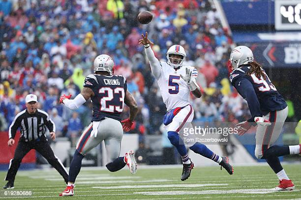 Tyrod Taylor of the Buffalo Bills throws for a completion against the New England Patriots during the first half at New Era Field on October 30 2016...