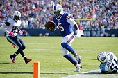 Tyrod Taylor of the Buffalo Bills tiptoes along the sideline on a 22yard touchdown run against the Tennessee Titans in the third quarter at Nissan...