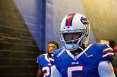 Tyrod Taylor of the Buffalo Bills waits to be announced at pregame ceremonies before the game against the Dallas Cowboys on December 27 2015 at Ralph...