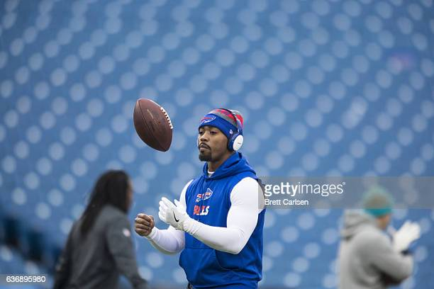 Tyrod Taylor of the Buffalo Bills warms up before the game against the Miami Dolphins on December 24 2016 at New Era Field in Orchard Park New York...