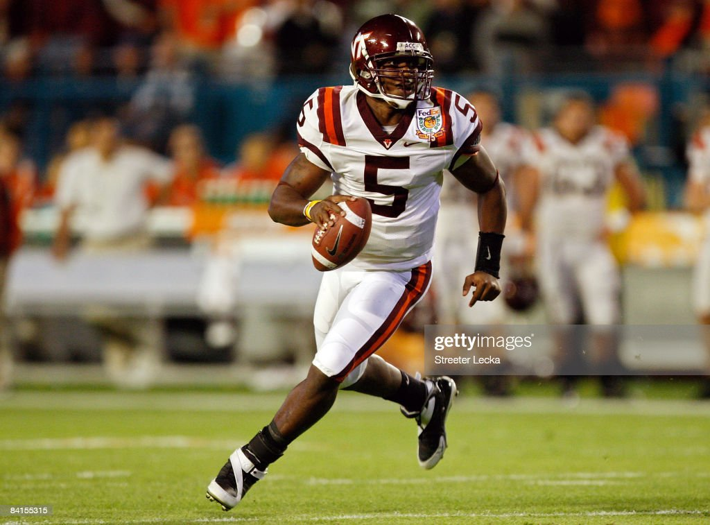Tyrod Taylor of the Virginia Tech Hokies runs with the ball during the FedEx Orange Bowl against the Cincinnati Bearcats at Dolphin Stadium on...
