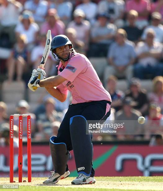 Tyron Henderson of Middlesex smashes the ball away for a boundary during the Twenty20 Cup Semi Final between Middlesex and Durham at The Rosebowl on...
