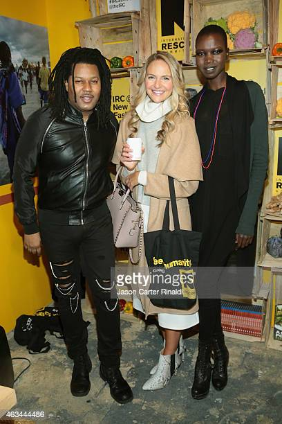 TyRon Mayes Jackie Miranne and Nykhor Paul attend IRC Fashion Week PopUp and Photo Exhibition at Empire Hotel on February 14 2015 in New York City