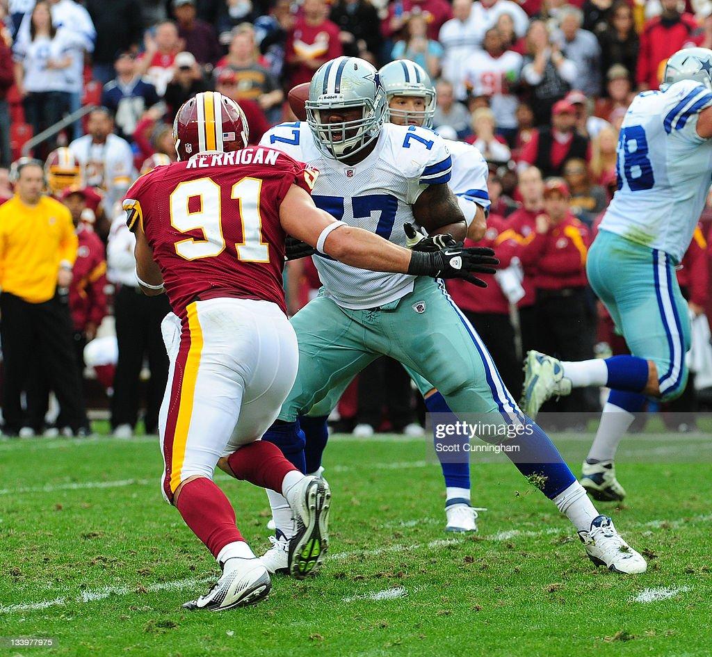 Tyron Smith of the Dallas Cowboys blocks against Ryan Kerrigan of the Washington Redskins at FedEx Field on November 20 2011 in Landover Maryland The...