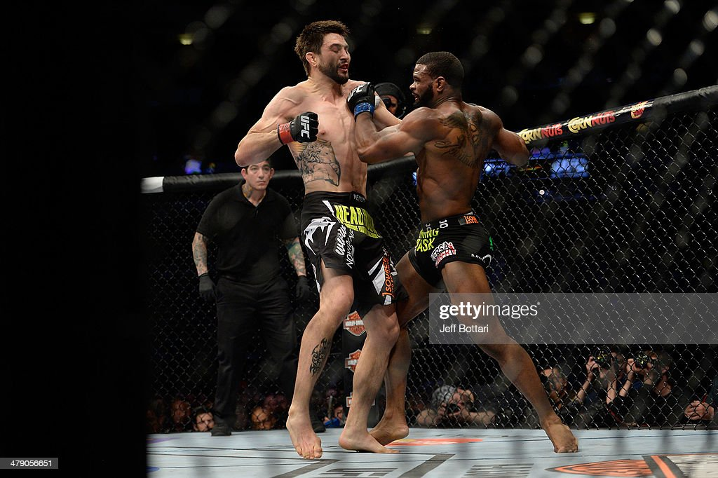 Tyron Woodley punches Carlos Condit in their welterweight fight during the UFC 171 event inside American Airlines Center on March 15 2014 in Dallas...