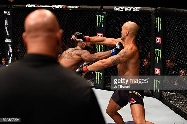Tyron Woodley punches Robbie Lawler in their welterweight championship bout during the UFC 201 event on July 30 2016 at Philips Arena in Atlanta...