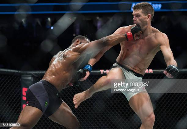 Tyron Woodley punches Stephen Thompson in their welterweight championship bout during the UFC 209 event at TMobile arena on March 4 2017 in Las Vegas...