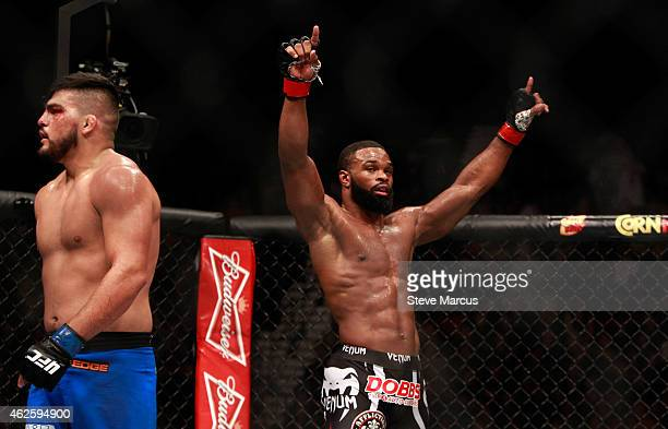 Tyron Woodley raises his arms after three rounds against Kelvin Gastelum in their welterweight bout during UFC 183 at the MGM Grand Garden Arena on...