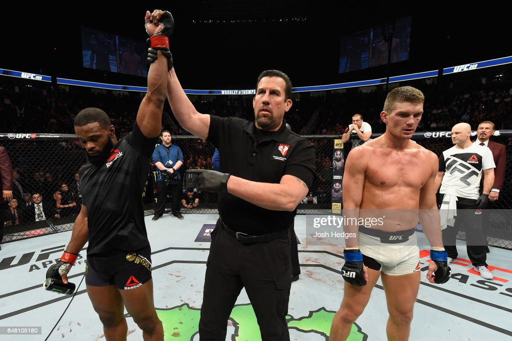 Tyron Woodley (left) reacts to his victory over Stephen Thompson (right) in their UFC welterweight championship bout during the UFC 209 event at T-Mobile Arena on March 4, 2017 in Las Vegas, Nevada.
