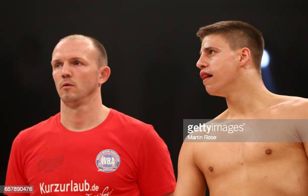 Tyron Zeuge of Germany and his coach Juergen Braehmer look on before the WBA super middleweight championship title fight at MBS Arena on March 25...