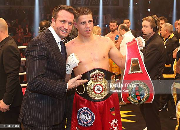 Tyron Zeuge of Germany and Kalle Sauerland pose after winning the WBA Super Middleweight World Championship title fight between Tyron Zeuge and...