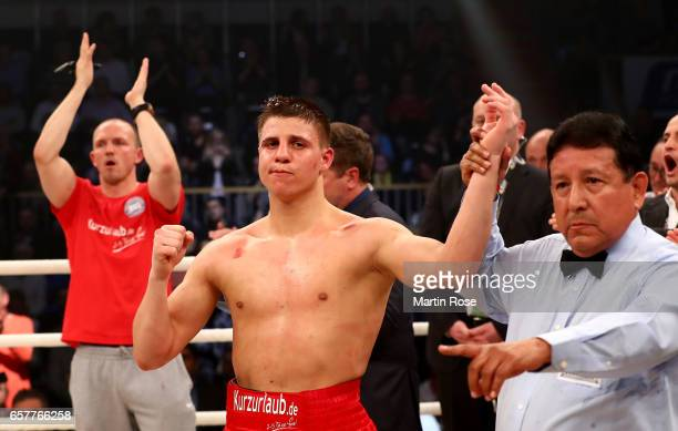 Tyron Zeuge of Germany celebrates the WBA super middleweight championship title fight at MBS Arena on March 25 2017 in Potsdam Germany