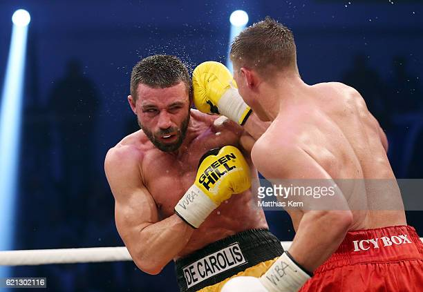 Tyron Zeuge of Germany exchanges punches with Giovanni De Carolis of Italy during their WBA Super Middleweight World Championship title fight at MBS...