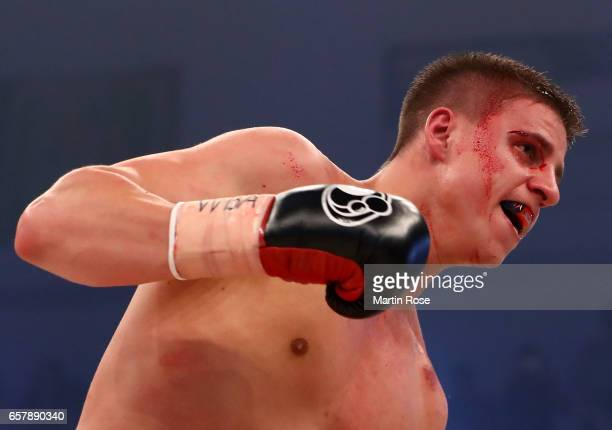 Tyron Zeuge of Germany in action against Isaac Ekpo of Nigeria during their WBA super middleweight championship title fight at MBS Arena on March 25...