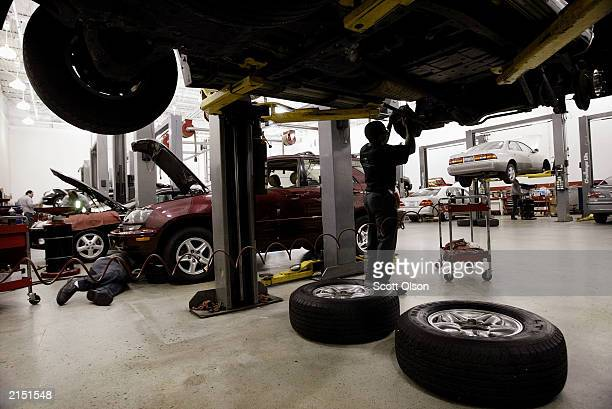 Tyrone Browley replaces the brakes on a Lexus LX470 at a dealership July 10 2003 in Chicago Illinois Lexus vehicles had the fewest reported problems...
