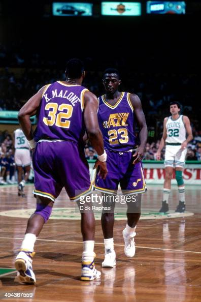 Tyrone Corbin and Karl Malone of the Utah Jazz on the court against the Boston Celtics during a game played in 1992 at the Boston Garden in Boston...