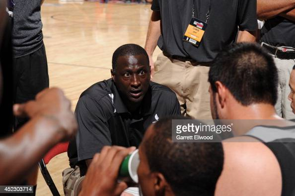 Tyrone Corbin Head Coach of the Sacramento Kings talks with his team during the game against the Charlotte Hornets at the Samsung NBA Summer League...