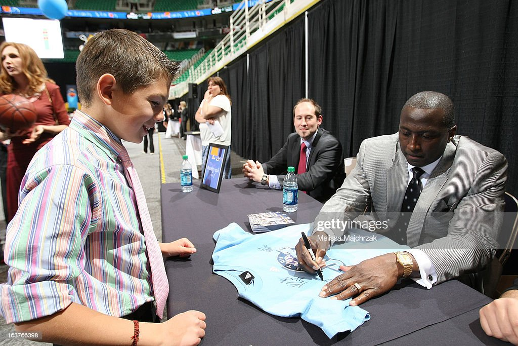 Tyrone Corbin Head Coach of the Utah Jazz signs an autograph for fan at the Leapin Leaners and Low Tops Charity Event at Energy Solutions Arena on March 14, 2013 in Salt Lake City, Utah.