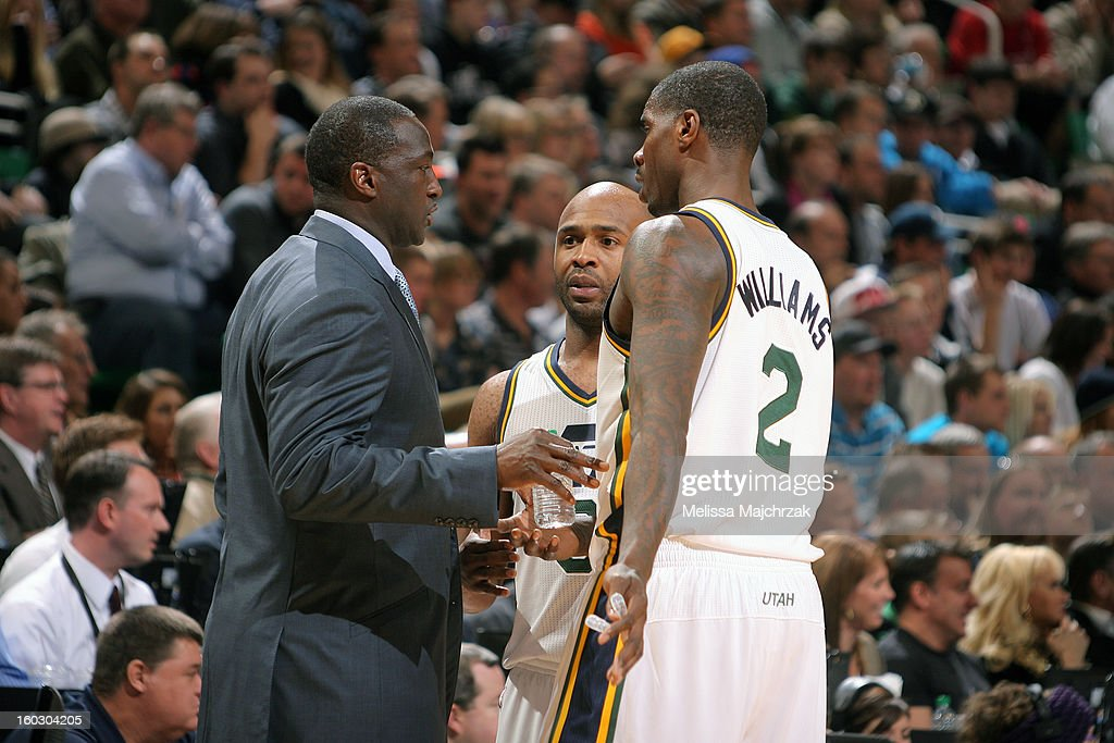 <a gi-track='captionPersonalityLinkClicked' href=/galleries/search?phrase=Tyrone+Corbin&family=editorial&specificpeople=829288 ng-click='$event.stopPropagation()'>Tyrone Corbin</a>, Head Coach of the Utah Jazz, talks with <a gi-track='captionPersonalityLinkClicked' href=/galleries/search?phrase=Jamaal+Tinsley&family=editorial&specificpeople=202203 ng-click='$event.stopPropagation()'>Jamaal Tinsley</a> #6 and <a gi-track='captionPersonalityLinkClicked' href=/galleries/search?phrase=Marvin+Williams&family=editorial&specificpeople=206784 ng-click='$event.stopPropagation()'>Marvin Williams</a> #2 during a break in play against the Miami Heat at Energy Solutions Arena on January 14, 2013 in Salt Lake City, Utah.