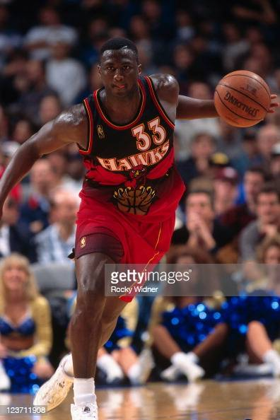 Tyrone Corbin of the Atlanta Hawks dribbles against the Golden State Warriors on February 4 1997 at San Jose Arena in San Jose California NOTE TO...