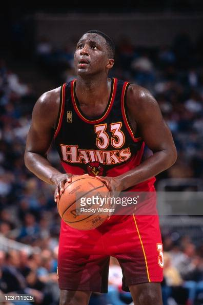 Tyrone Corbin of the Atlanta Hawks shoots a foul shot against the Golden State Warriors on February 4 1997 at San Jose Arena in San Jose California...